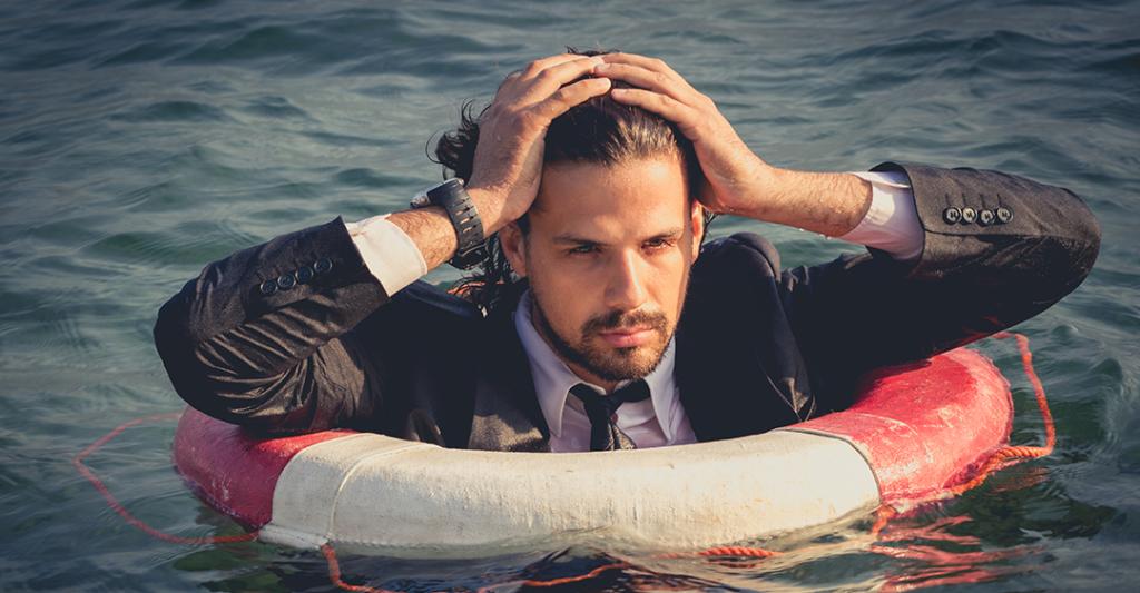 man in water wearing lifebuoy, business relief, business survival, coronavirus