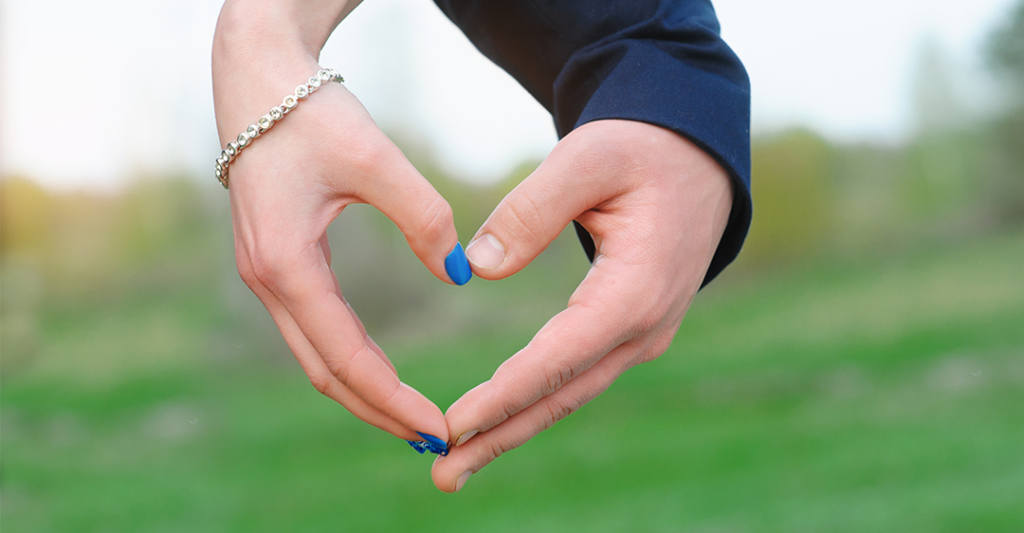 foreign prenuptial agreement, prenup, marital contract, hands making heart