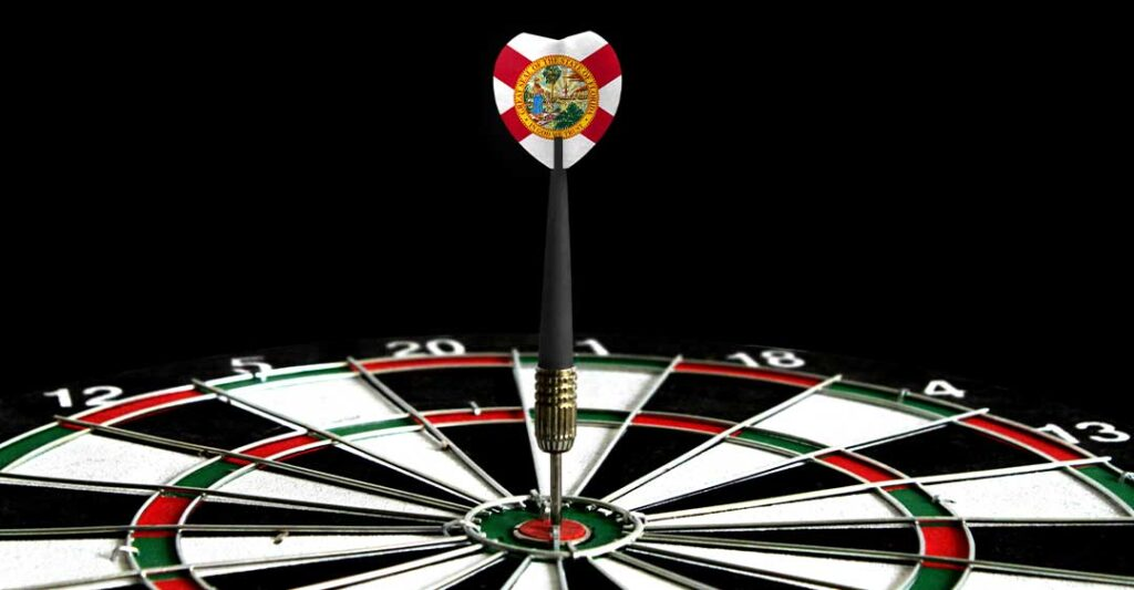 state of florida flag on dart flight, dart tip in bullseye of dartboard, Move your business to florida