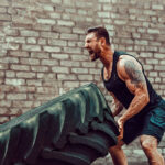 muscular man lifting large tire, Boyer Law Firm, P.L. - Florida, Let us do the heavy lifting