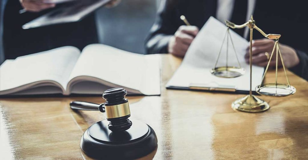 books, documents, weight scale and gavel on table, civil litigation process explained