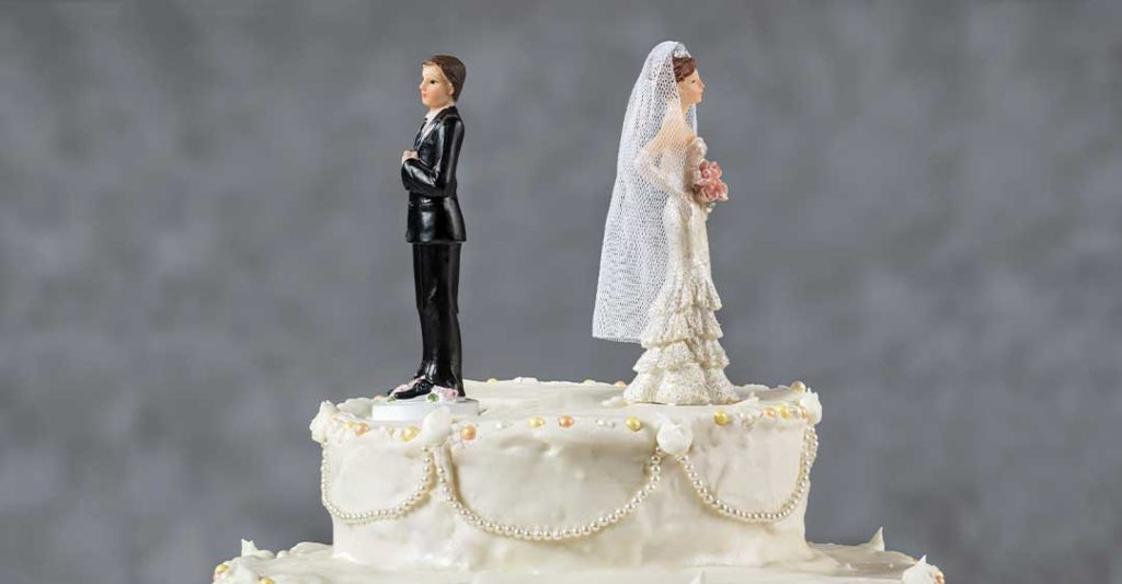 bride and groom topper on wedding cake facing away from each other , The Consequences of Divorce on Your Estate Plan