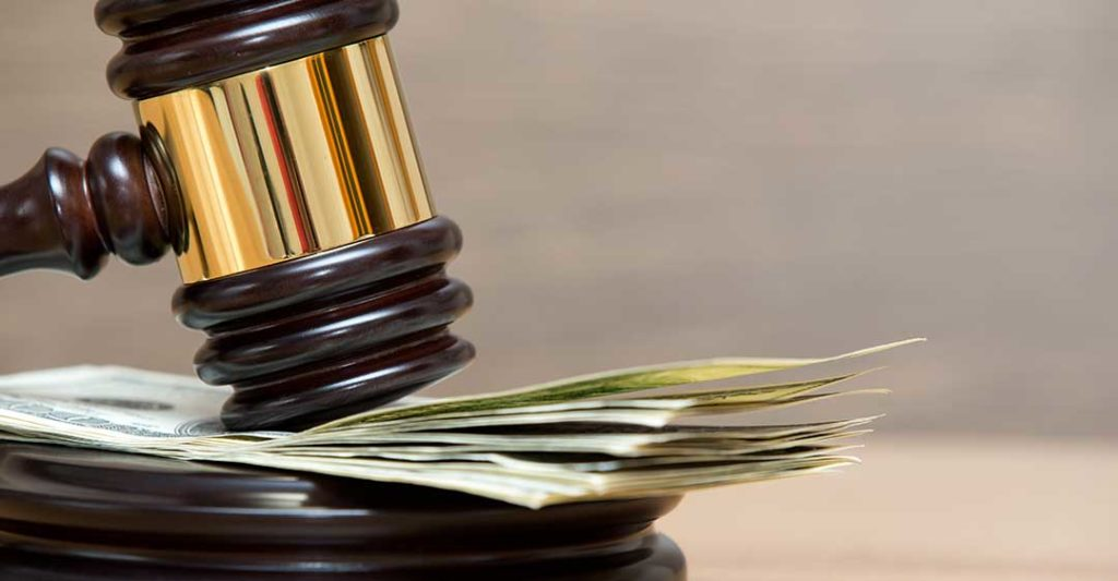 gavel resting on money, disadvantages of private trial for businesses, voluntary trial resolution