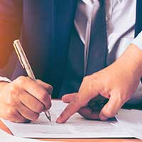 lawyer pointing to document, man signing document, florida personal representative