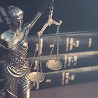 lady justice statue, law books, florida probate attorneys