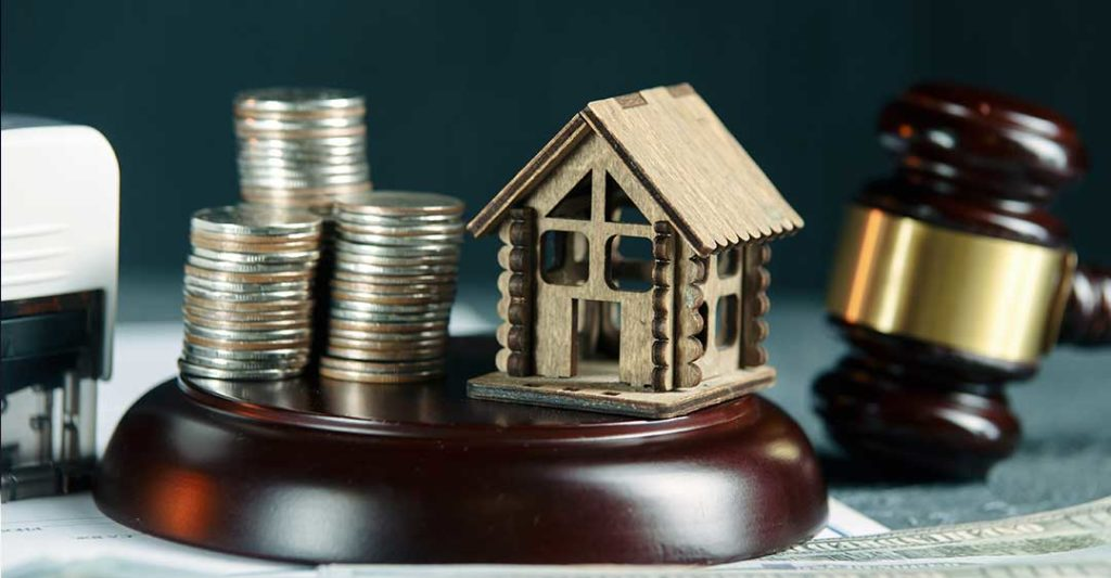 stack of coins and house with gavel, can creditors place a lien on a business, business liens