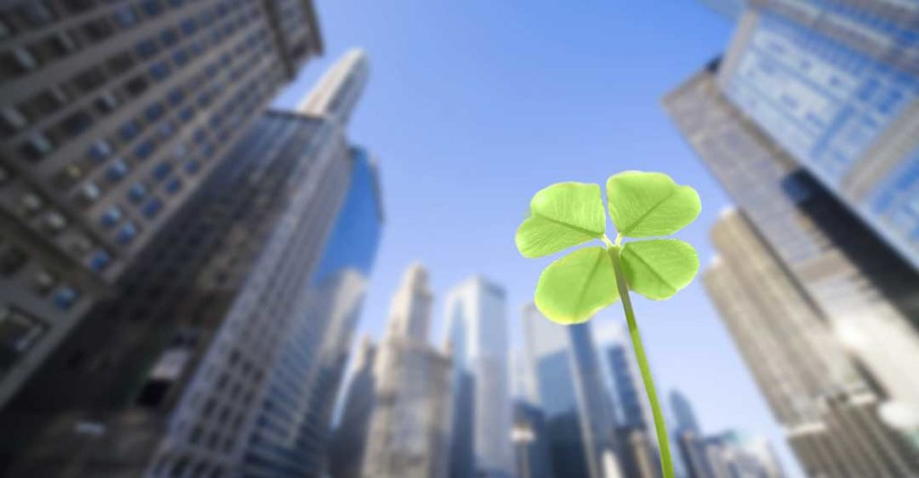 four leaf clover with city skyscrapers, luck in business success