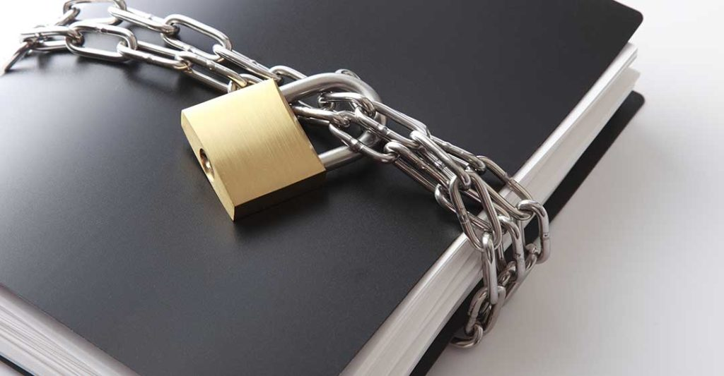 black binder wrapped in chain with padlock, non-compete agreements