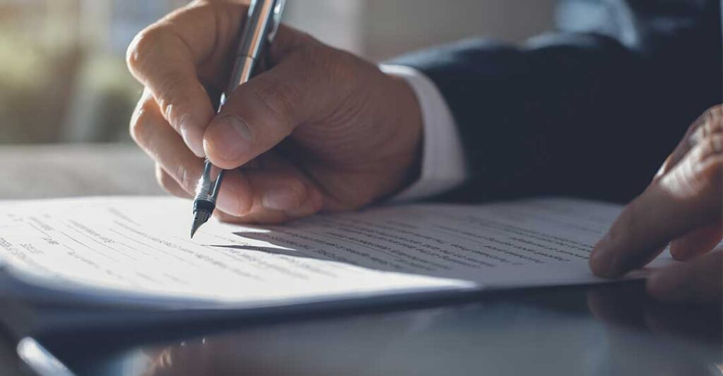 businessman signing document, non-compete agreements