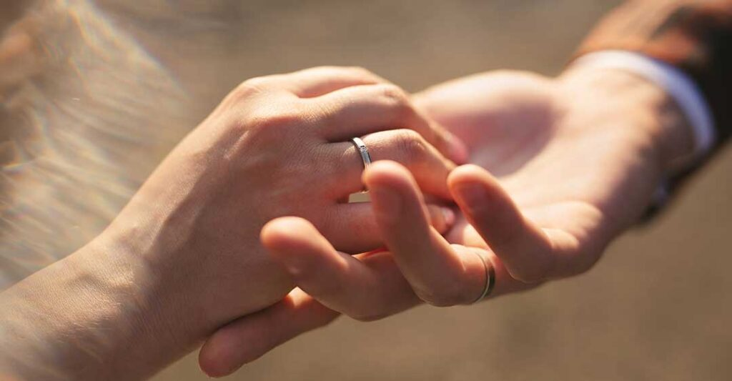 bride's hand in groom's hand, create a prenuptial agreement with a foreign fiancé, marriage contract, marital contract