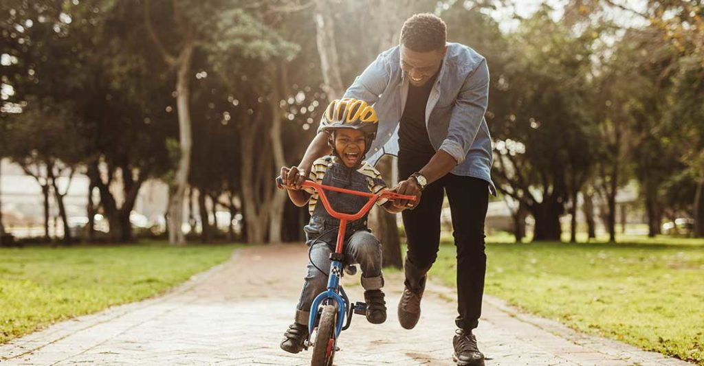 father pushing his son on bicycle, impact of child support obligations on a second marriage