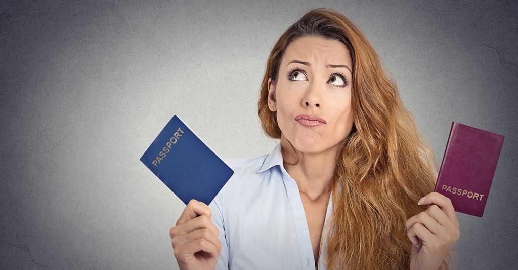 woman holding two passports, second passport problems