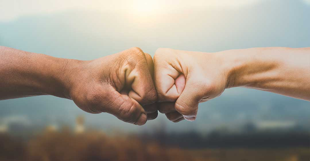 Men giving fist bump, power of teamwork, friendship, business startup, co-founders, should you start a business with a friend?