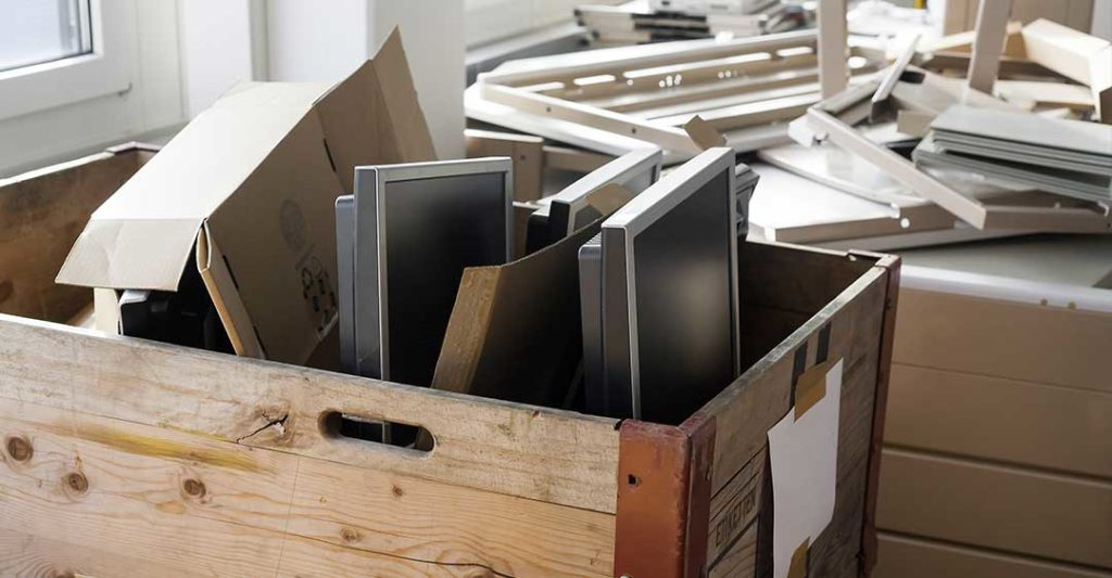 boxes of office equipment and computer monitors, total liquidation vs going out of business
