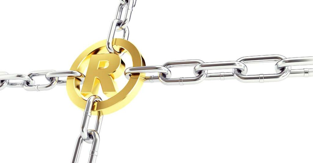 gold registered trademark emblem with chains connected, willful intent monumental to trademark law